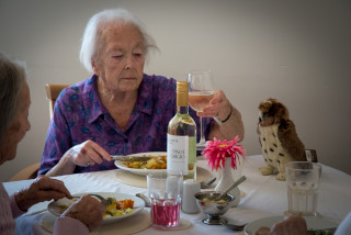 Hollybank residents at dinner with wine